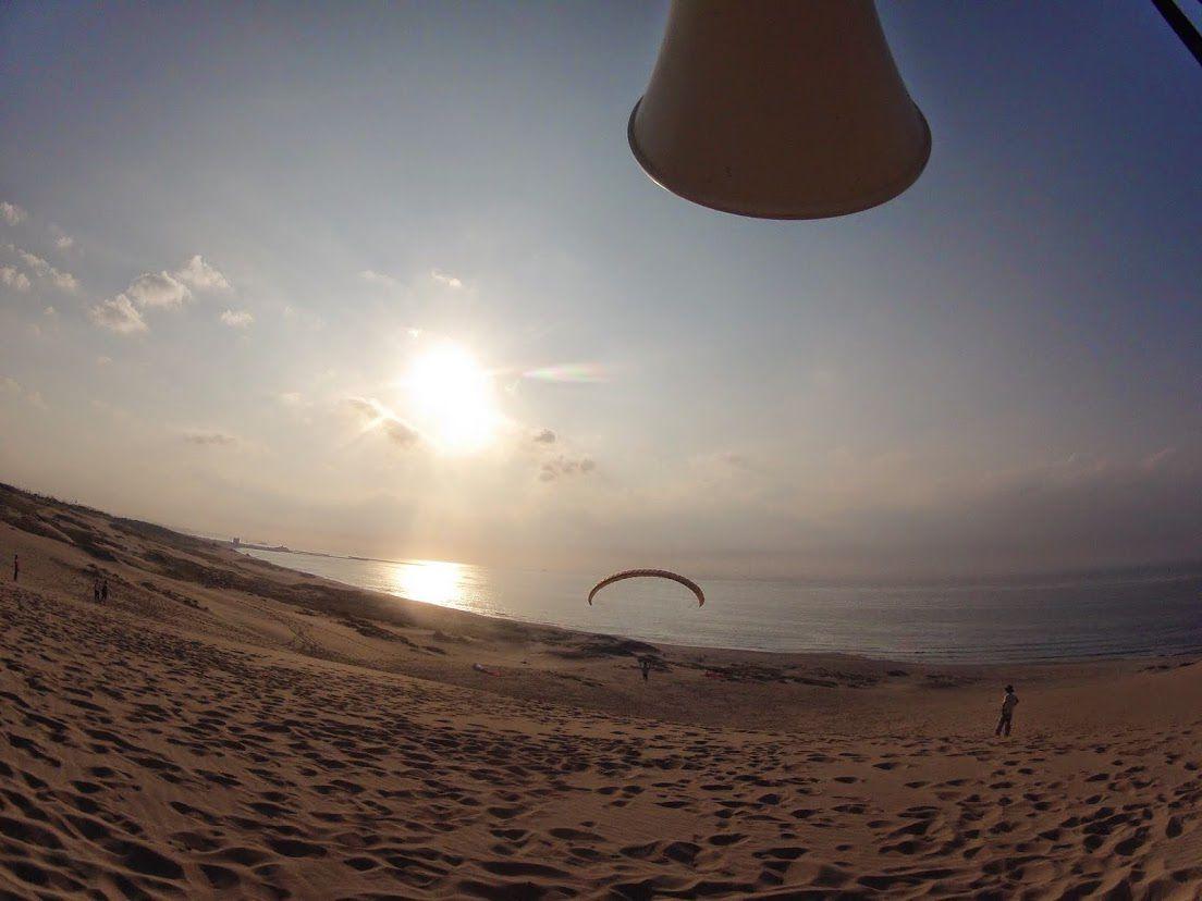 夕日パラグライダー砂丘